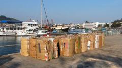 Paper Carton for recycle at Cheung Chau island waterfront Hong Kong China Asia Stock Footage