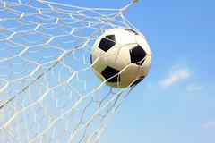 Soccer ball in net Stock Photos