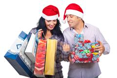 Satisfied Christmas couple of  their purchasing things Stock Photos