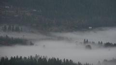 Aerial time-lapse, fog dissipating through forest at dawn Stock Footage