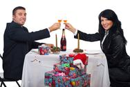 Stock Photo of Couple toast with champagne at Christmas dinner