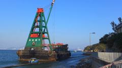 Barge loading rock to shore Cheung Chau island Hong Kong China Asia Stock Footage