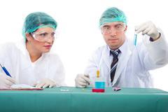 Chemists teamwork analyze tube with liquid Stock Photos