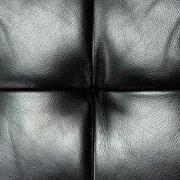 dark leather texture of sofa closeup shot - stock photo