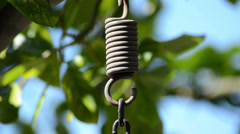 Hanging metal string on a natural environment Stock Footage