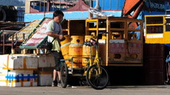 Harbor Harbour worker moving delivering bottle gas Cheung Chau island Hong Kong - stock footage