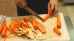 Stock Video Footage of Chef cutting carrots on board in restaurant
