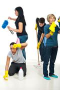 People teamwork work to cleaning house - stock photo