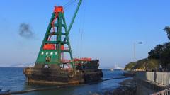 Barge loading rock to shore Cheung Chau island Hong Kong China Asia - stock footage