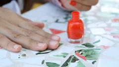 Nail polish that is red  is painted on her fingernails. HD 1080 Stock Footage