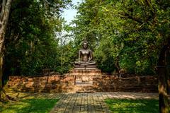 sitting buddha statue in tempel thailand - stock photo