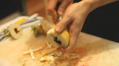 Stock Video Footage of Peeling artichoke