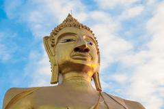 buddha statue and blue sky - stock photo