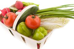 Wattled basket with vegetable - stock photo