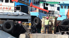 Time Lapse  Harbor Harbour worker collecting wooden pallets Cheung Chau island Stock Footage