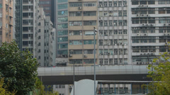 Highway Expressway along apartment building Central Financial district Hong Kong Stock Footage