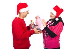 Man receive a surprising Xmas gift from his wife - stock photo