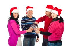 Four  friends celebrate Christmas night - stock photo