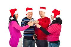 Four friends cheers for Christmas Stock Photos