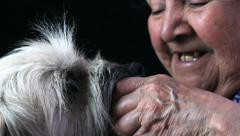 Aged woman enjoying her pet Stock Footage