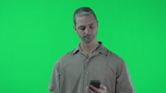 green screen, man on cellphone, not happy, a little disappointed - stock footage