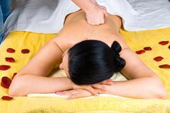 Deep back massage woman - stock photo