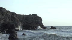 Turbulent water on a rocky coastline Stock Footage