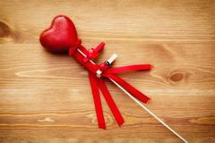 Beautiful red heart on a wand Stock Photos