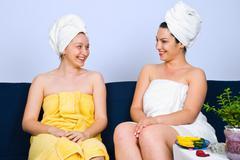 Women  happy conversation at spa salon - stock photo