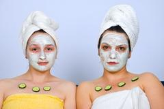 Portrait of women with facial mask - stock photo