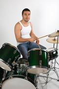 Young man drummer - stock photo