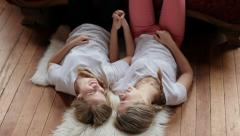 Sisters Hold Hands, Talk, With Their Feet On A Chaise Lounge Stock Footage