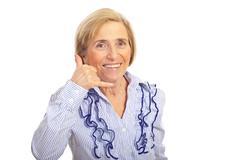 Cheerful senior gesturing call me - stock photo