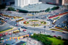 roundabout in the city at rush hour - stock photo