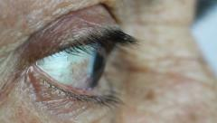 Flange, eyelid and eye of an old woman - stock footage