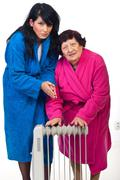 Cold shivering  women with radiator heat Stock Photos