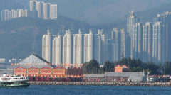 Time Lapse  Star ferry passing Bamboo Opera construction at Kowloon West Hong Stock Footage