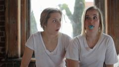 Friends Have A Bubble Gum Blowing Contest Stock Footage