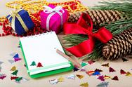 Stock Photo of christmas decorations, gifts and a notebook for congratulations.