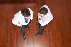 Top view of business men telling secret Stock Photos