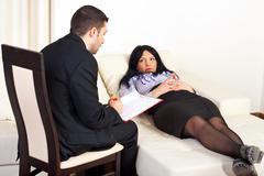 Psychiatrist advice patient woman - stock photo