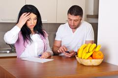 Couple having difficult to calculate expenses Stock Photos