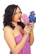 Cute woman smelling hyacinth Stock Photos