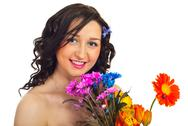Portrait of smiling woman with flowers Stock Photos