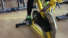 Female exercising their legs doing cardio cycling training Stock Footage