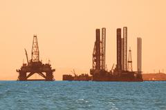Oil rig during sunset in Baku, Azerbaijan in Caspian Sea - stock photo