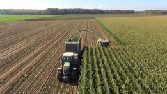 Aerial view of a farmer harvesting silage - stock footage