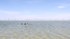 Salt Lake Baskunchak, Russia. May 11, 2013. Man swimming . Stock Footage