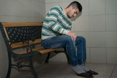 young man prepairing to take ablution - stock photo