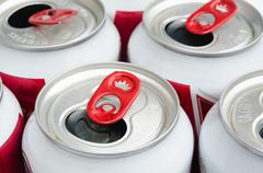 part of empty aluminum can with red opened - stock photo